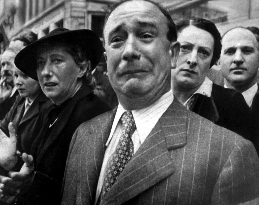 w-eugene-smith-a-frenchman-weeps-as-german-soldiers-march-into-paris-june-14-1940.jpg