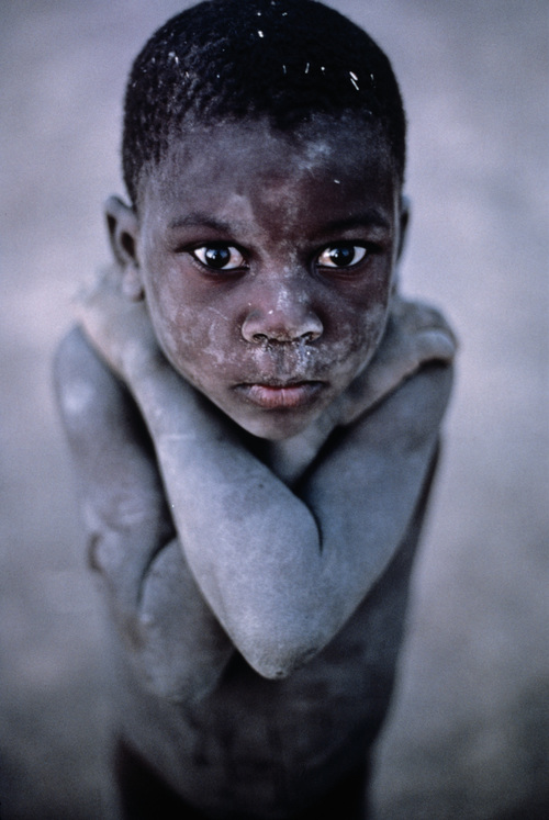Steve McCurry- South Africa. Not possible to take a shot like this with a small camera (without instagram or photoshop)