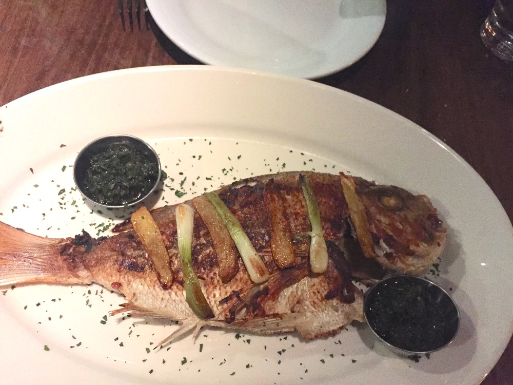 Wild Sea Bream from New Zealand, with ginger, green onion, and house made chimichurri, presentation before de-boning