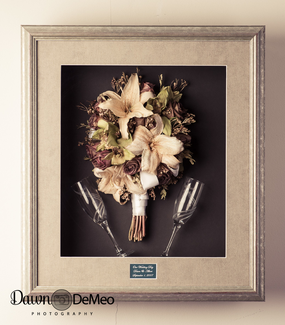 Day 38 - Feb 7: Memories. I had my wedding bouquet freeze-dried and preserved in a shadow box along with our toasting flutes.