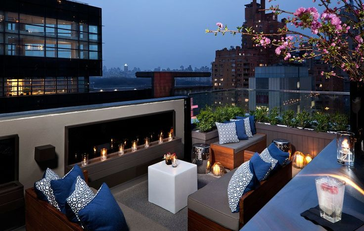 The roof top lounge at  6 Columbus.  Image via  here