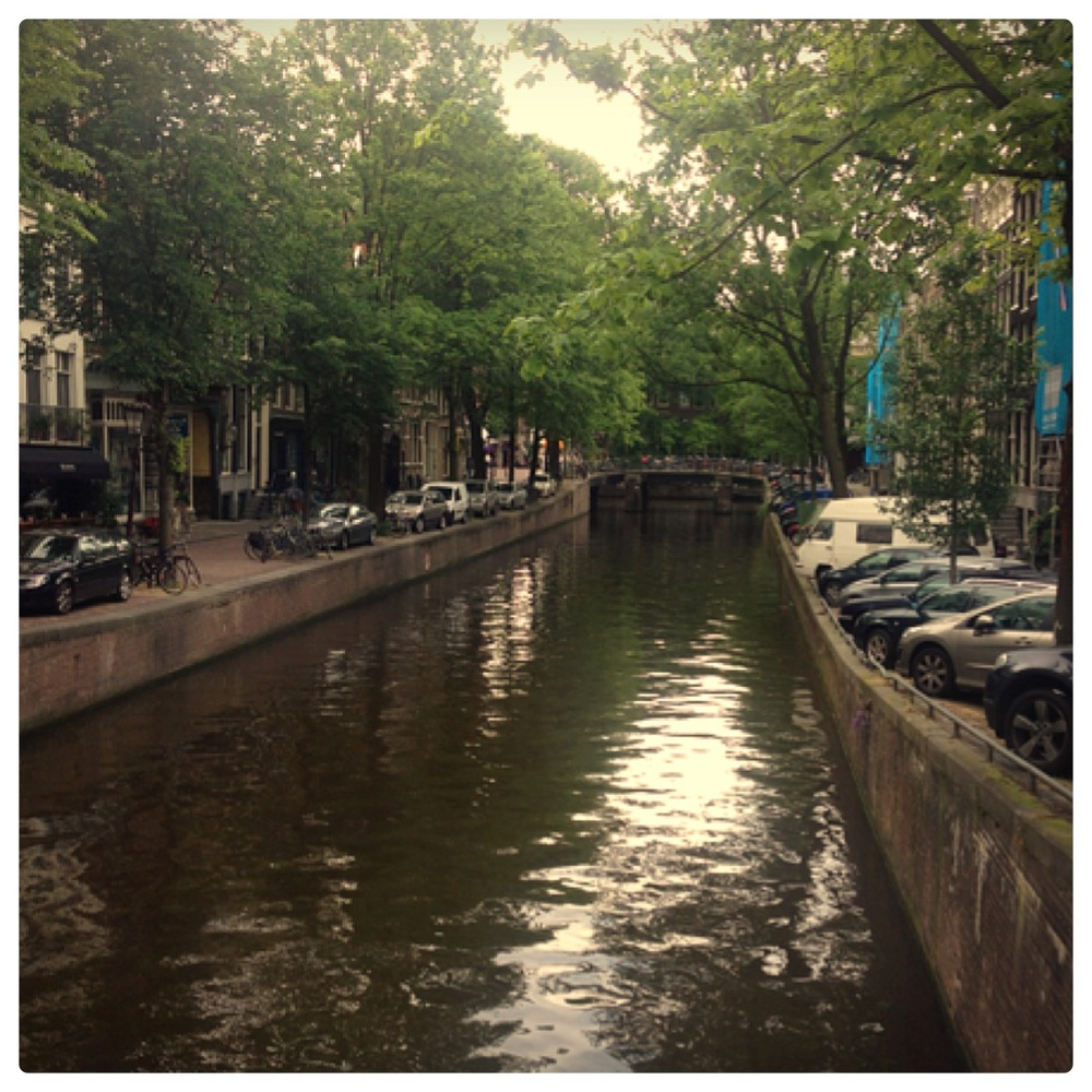 Strolling along the canals on a cloudy day.  Taken with my iphone