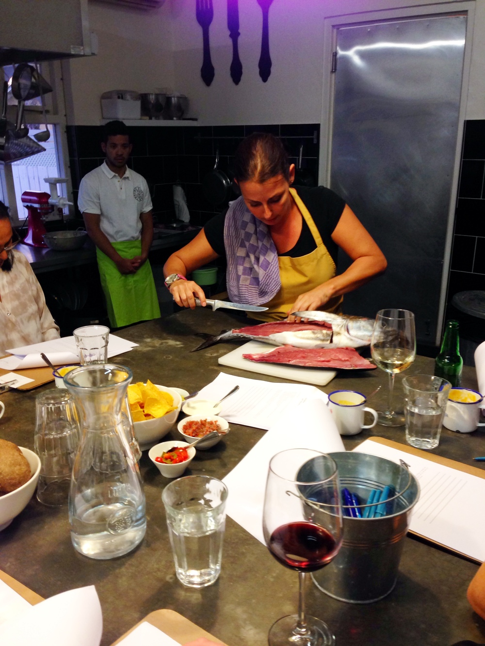 Image from my own collection. Learning how to fillet a tuna for the ceviche.  Spice Girl.