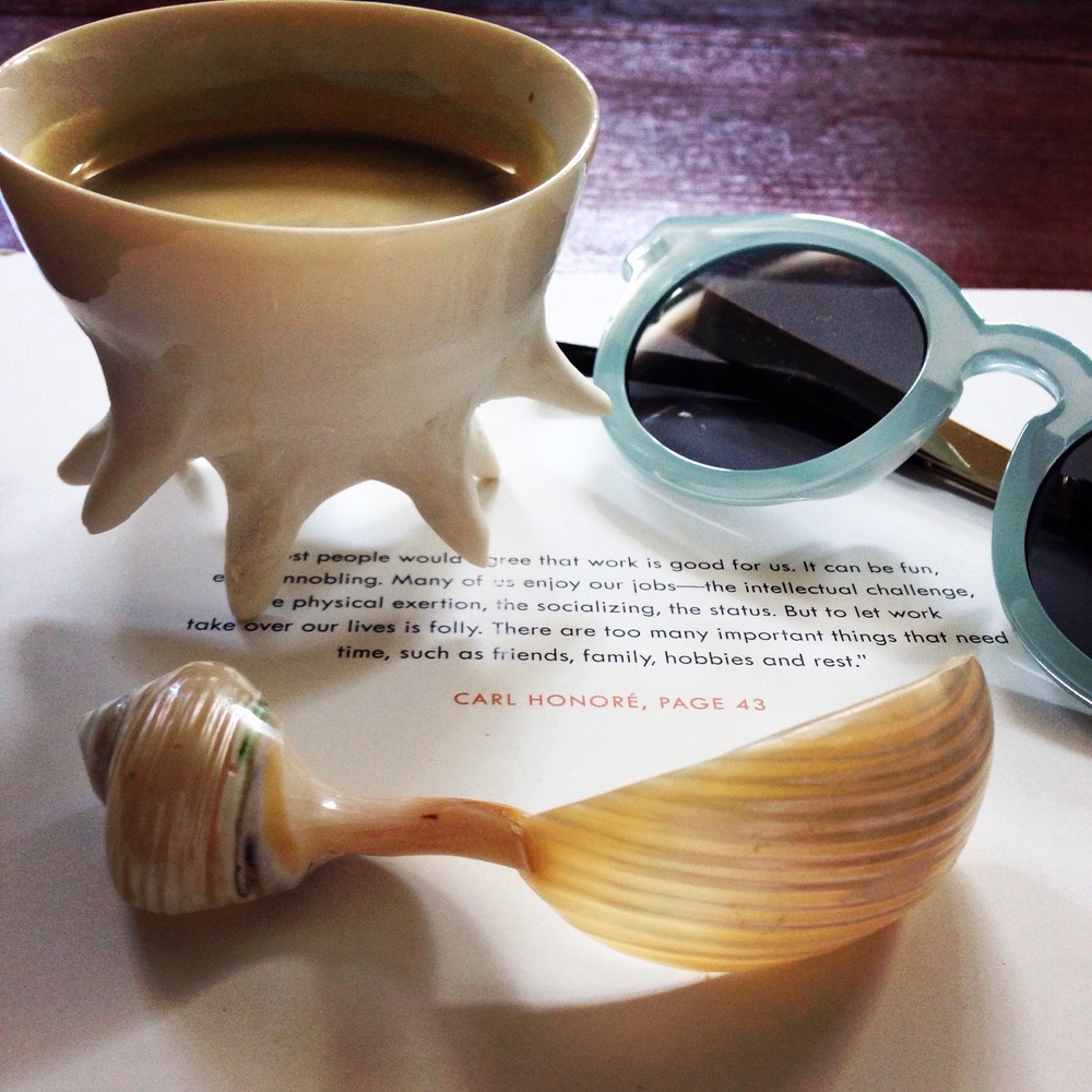 Cup and spoon from  Chora  in Mykonos. Sunglasses from Other Stories.