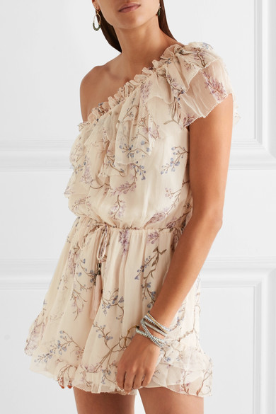 "Image via Net-a-Porter: ""Named after the idyllic Dutch Caribbean island, Zimmerman's 'Curacao' playsuit is cut from cream silk-chiffon and printed with delicate blue and lilac florals""."