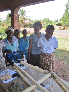 Village women observing the bike-building process