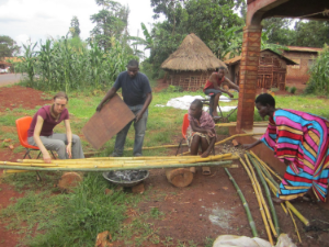 Laurel, Brian and women from the village help roast the bamboo poles