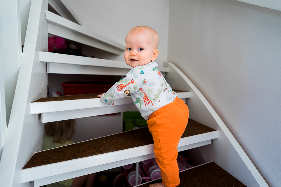 Meri climbes the stairs for the first time. Sony A7 & ZEISS Batis 2/25 – f/2.0, 1/60sec, ISO160, raw Photograph by Toni Ahvenainen
