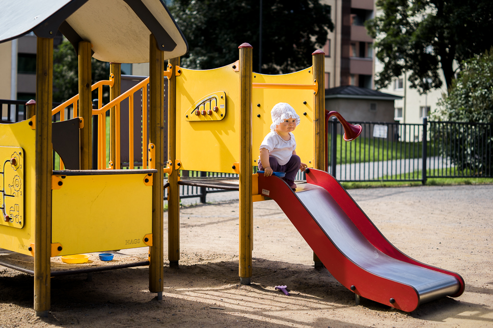 Meri learns to slide. Sony A7 & ZEISS Loxia 2/50 – f/2.8, 1/1000sec, ISO100, raw Photograph by Toni Ahvenainen
