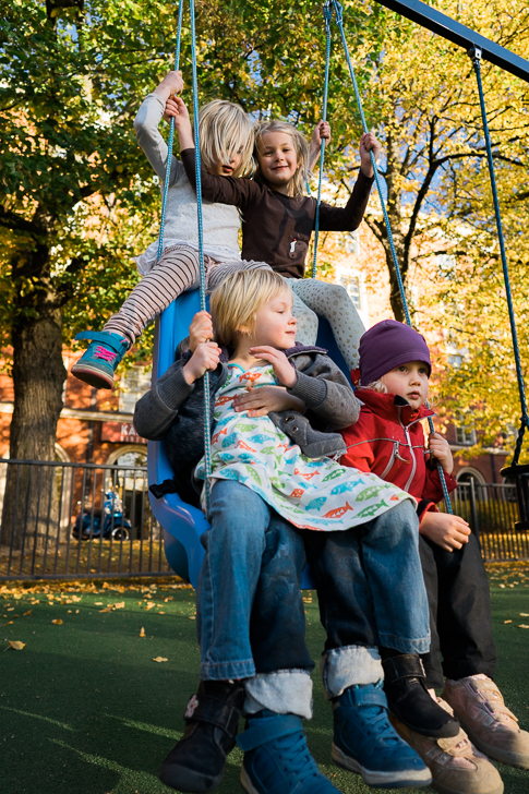 Five kids in a one swing. Sony A7 & ZEISS Batis 2/25 – f/3.2, 1/320sec, ISO1000, raw Photograph by Toni Ahvenainen