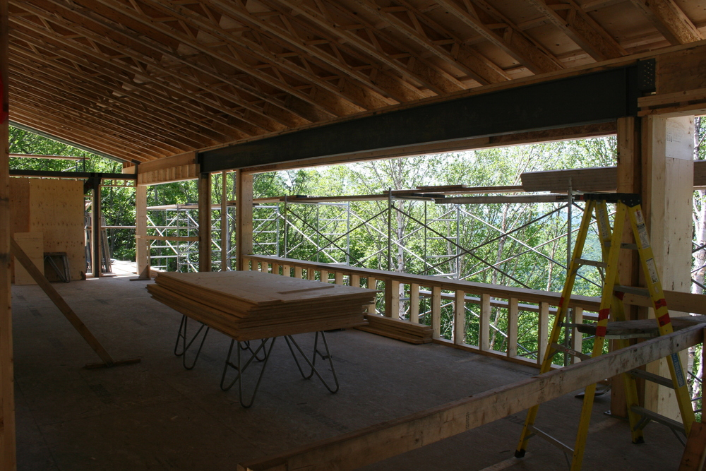 View of tree tops thru 27' bay window, with Lac Archambault below...
