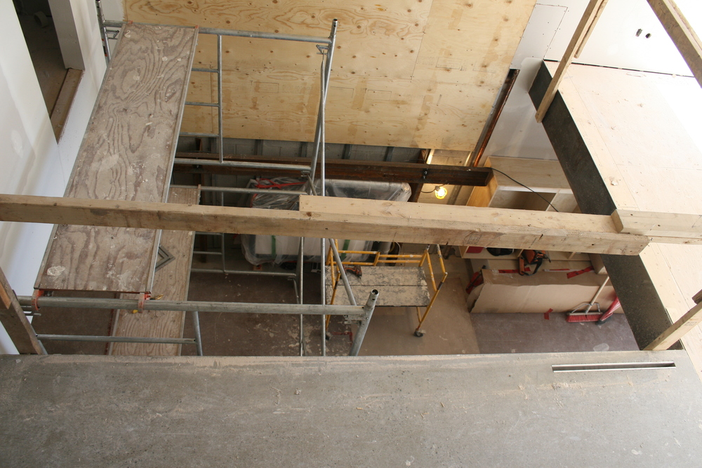 Looking into dining room and kitchen from 2nd floor bridge