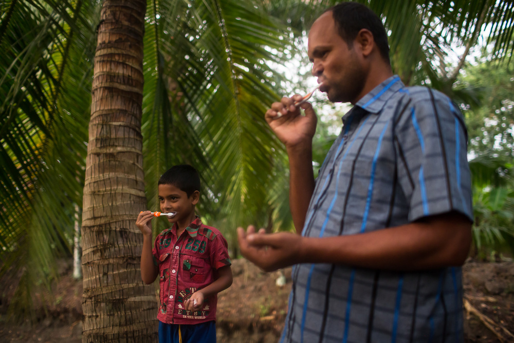 Bulbul, 7, and his father Mambubur Rahman (Babul), 36, brush their teeth in the morning.
