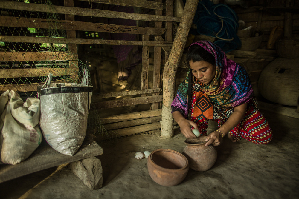 Before becoming a fish farmer, Ruma Begum raised chickens and ducks.
