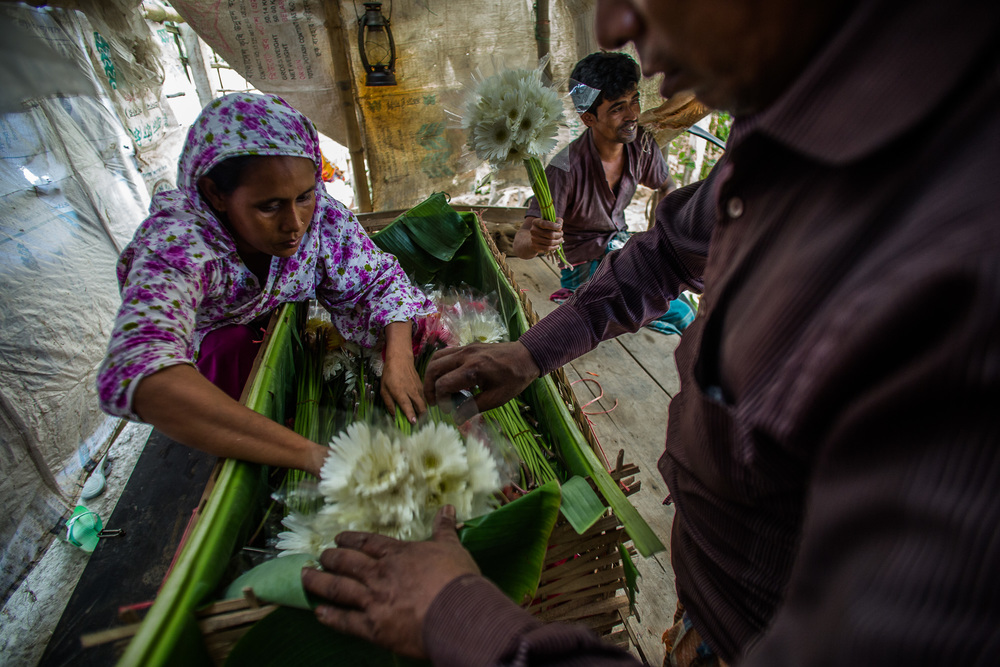 One of the things Sajeda learned in the training was how to better package her flowers before selling to buyers to preserve them during the transport process. Photo by Josh Estey