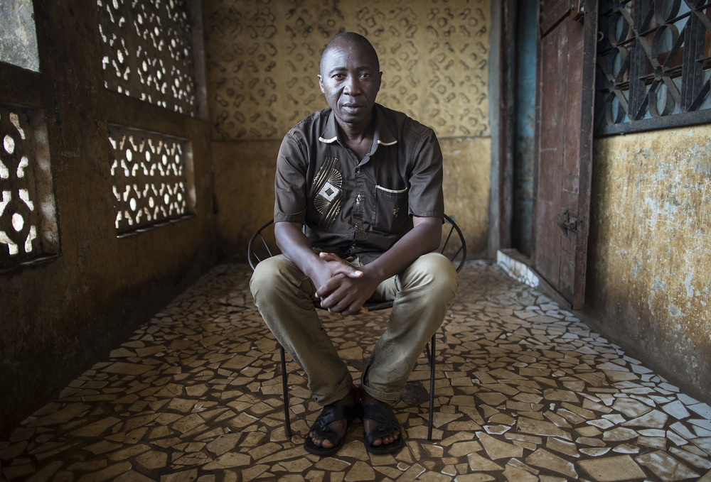 "CONAKRY, GUINEA: ""The first person who was sick was my sister,"" remembers Ismael Koulibaly. ""She was sick but we didn't know she was sick. We thought it was a pulmonary disease. We took her to a clinic and there was another person who had Ebola while we were there. This is how we think she came down with Ebola."" They took her to her parents house. She stayed for five days and then she passed away. They called the Red Cross who confirmed she died of Ebola. The family was scared. The Red Cross, UNICEF and the chief helped to explain the disease to them. Ismael was the first one to accept that his sister had died of this mysterious disease called Ebola. ""It wasn't easy for the family to accept. At first, the family was scared. Again, many of the people didn't go to school so it was difficult for the family to accept that it was Ebola. Since I am the one who is educated, I had to explain everything to the family for them to accept it. If I didn't convince my family, many people were going to die and it was going to be a disaster."" Photo by Sarah Grile"