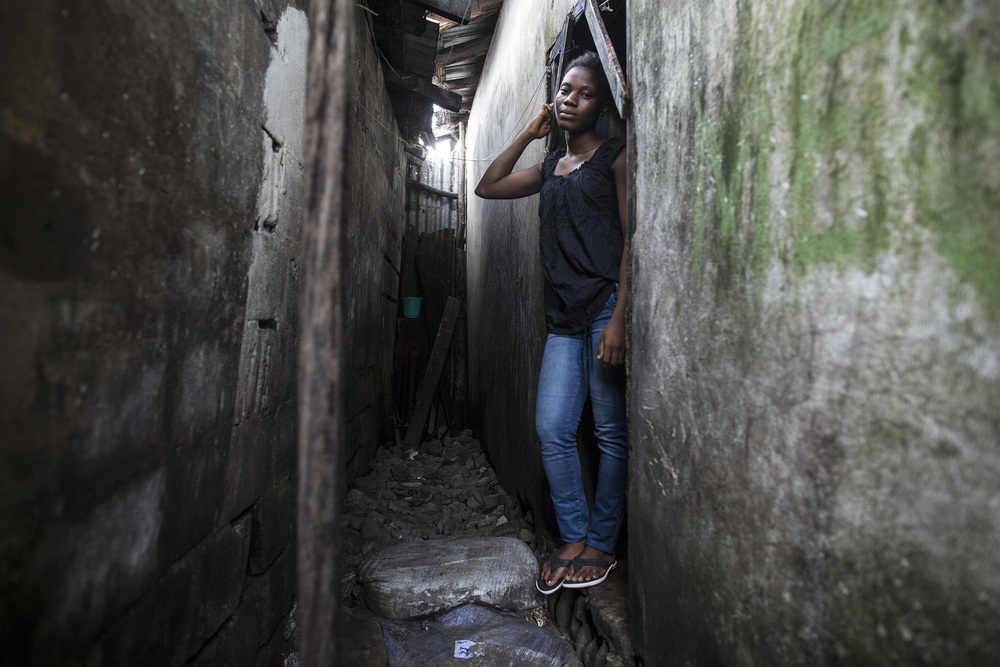 "MONROVIA, LIBERIA: Jessica Meufville, 17, is a student in 10th grade in West Point — a slum in Monrovia's capital, Monrovia. Jessica was staying with her parents in West Point when Ebola came into the country. ""Sometimes I was really scared because of the information being spread around about Ebola. ""I was thought if I looked at someone with Ebola I would get it. If I came down with Ebola automatically all my family would get it."" In August of 2014, West Point was quarantined after Ebola patients escaped from a holding center. She remembers finding out in the morning, since it occurred during the nighttime. She said, ""It was shocking to everyone. The whole time, everything was confusing, even your close friends you could not see. No one was moving. Everyone was staying at home."" She and other young girls from West Point were part of a program headed by UNICEF's Hawa Page. These girls decided to meet at the West Point Women's Center. Their first meeting was on a Saturday. She remembers about 25 people being present. This is when they formed the group Adolescents Leading an Intense Fight Against Ebola or A-LIFE. She learned that Ebola was quite different then what was being spread around. We wanted to help save the lives of her fellow residents. ""We wanted to go door to door and tell people to follow preventative measures."" They did training and were given protective wear. ""It was challenging. A lot of people never accepted the message. It used to make me feel bad. Our supervisor always used to encourage us. It was that motivation that kept me moving on to talk with people for more lives to be saved."" They ended up doing the awareness for 6 months. Now, Jessica is back in school and hopes to become a journalist to ""help speak for the speechless."" Photo by Sarah Grile"