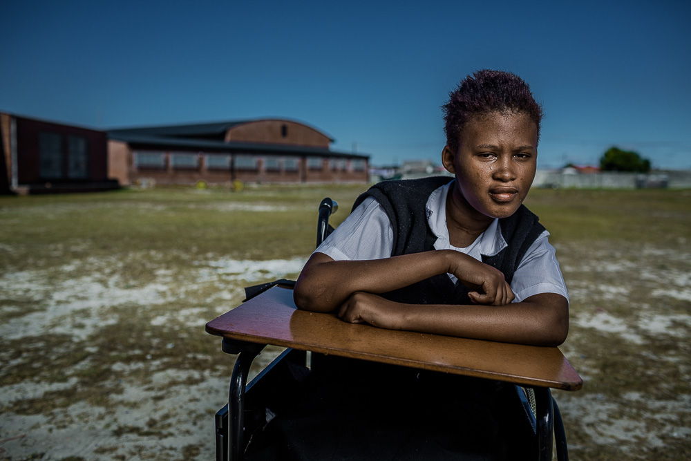 GUGULETHU, SOUTH AFRICA: March 10, 2016 - Siphosetu, 13, is a student at Tembaletu -- a school for physically disabled children located in the township of Gugulethu outside of Cape Town. Many children of Tembaletu wake as early as 4am to begin their long journey to the school. These children are susceptible to abuse, while also facing exhaustion from their long day. Each student faces challenges in their school attendance as they are highly susceptible to disease and injury, which can keep them away from school for months at a time and prevent them from completing their education. In 2011, Hillsong House was constructed as a dormitory that provides a secure homely environment for 32 of the most high risk children. The home provides a safe haven for each of these children to learn and grow. Photo by Morgana Wingard