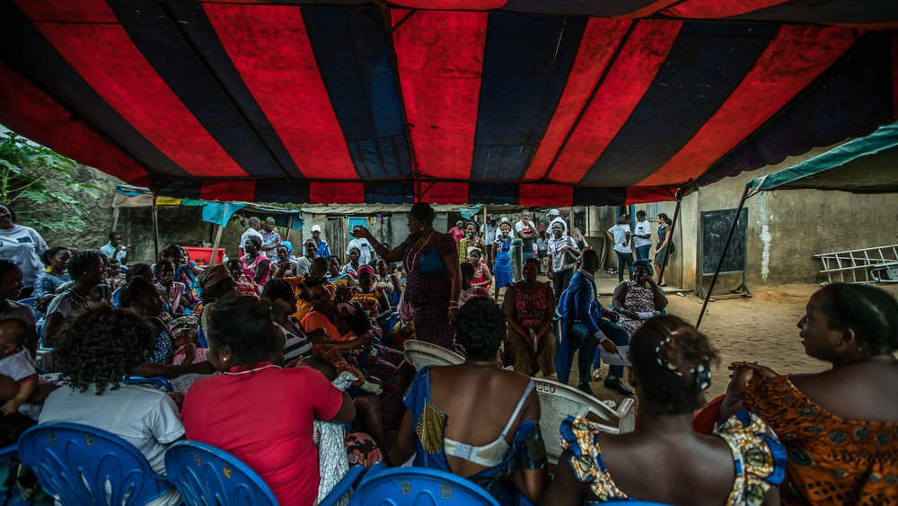 ABIDJAN, COTE D'IVOIRE – September 5, 2016:   CARE France Study Tour visits a Mother's Group in Abidjan. Visite de terrain d'un projet de Santé et planning familial avec Action Contre la Faim – Dans le cadre du projet PARSSI du Ministère de la santé. Ce projet, situé dans le quartier du Koweït à Abidjan, permet aux femmes de se retrouver une fois par semaine en groupe de parole, en classes, supervisé par une sage-femme et un-e agent-e communautaire qui répond à toutes leurs questions relatives aux droits sexuels et reproductifs et à la santé maternelle et infantile.Photo by Morgana Wingard
