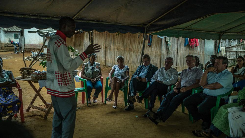 SONGON FURE VILLAGE, COTE D'IVOIRE – September 8, 2016: CARE France visite d'etude visite de terrain d'un projet d'associations villageoises d'épargne et de crédit (AVEC) avec CARE Côte d'Ivoire. Les groupements d'AVEC permettent aux femmes d'épargner en commun et d'avoir des ressources suffisantes pour développer des activités génératrices de revenus ou d'investir dans l'éducation ou la santé de leur famille. En parallèle, les femmes améliorent leur estime de soi, gagnent une meilleure compréhension de leurs droits et participent activement aux espaces de décision.  Photo by Morgana Wingard