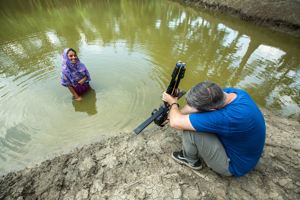 BALOVADROPUR, BANGLADESH: May 14, 2016 -  Ruma Begum, her husband and their son live in Balovadrapur village of Morelgonj Upazilla of Bagerhat District in Southern Bangladesh. They own 20 decimals of land (.2 acres) where they raise fish in 3 ponds to sell for local consumption. During 2013 Ruma became a beneficiary of the USAID-AIN (World Fish) Project and received 8 training sessions on carp and prawn culture with dike cropping. She also received 4 sessions of refresher training in 2014. She is now producing more fish and vegetables following improved knowledge and technology received from AIN. The new techniques have helped to increase their income. They spent their extra income on their family and invested more in their fish nursery. Photo by Morgana Wingard