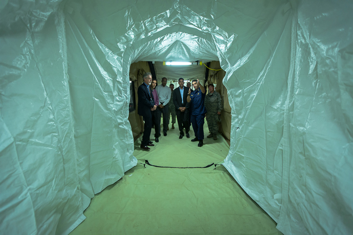 "Tents are connected by a covered passageway inside the ""Hot Zone.""  Soon the only people inside this area will be health workers either as patients or suited up in personal protective equipment."