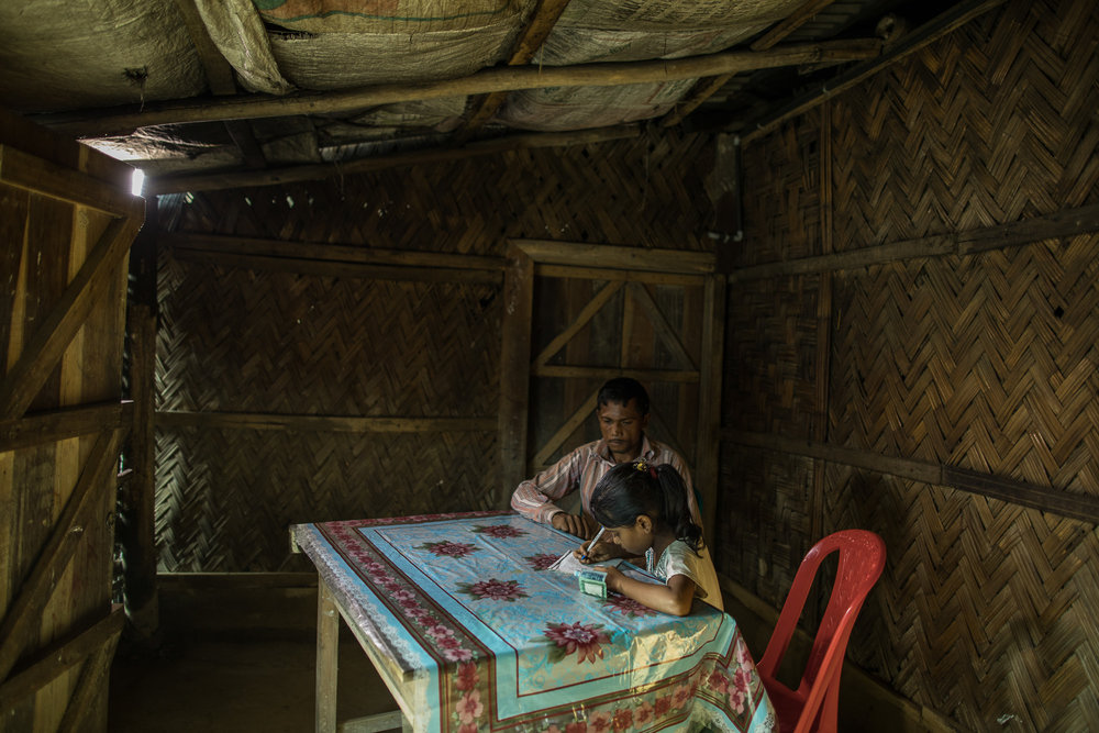 COX'S BAZAR, BANGLADESH: October 25, 2016 - Now that Joynur Jahan Joba, 10, can read she does tthe accounts for her father, a day laborer, and reads bills for him. Photo by Morgana Wingard