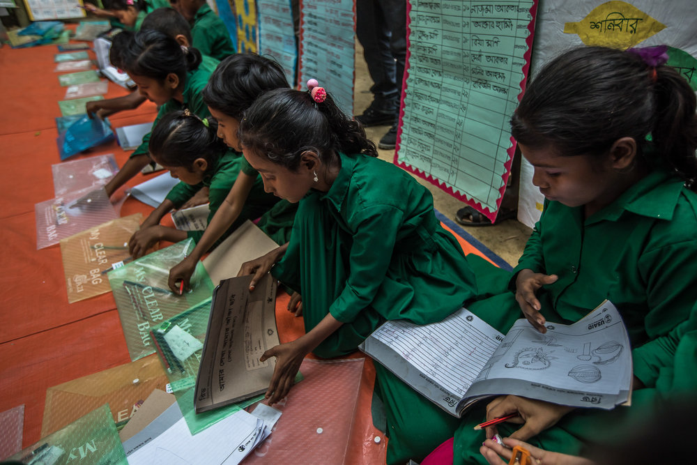 COX'S BAZAR, BANGLADESH: October 25, 2016 -  In Bangladesh, the number of contact hours in school is very low compared to other countries which constrains the time children have to practice reading. Without opportunities to practice reading outside school, it is difficult for children to become fluent readers or to understand what they read. Moreover, in a system geared to passing exams, memorization of textbooks is believed to lead to the best results. This means that many teachers and parents discourage reading books other than textbooks because it is considered a waste of time.  Given this backdrop, early grade education in Bangladesh often focuses on memorization of textbook content. In the little time available in Bangla lessons, questions and dialogue are not encouraged. The physical space of the classroom does not allow for participation or interaction other than the teacher-centric approach. Where class sizes are large, there is no room to change the classroom lay-out. Despite a primary curriculum that focuses on competencies, factors such as these constrain children from gaining strong foundational skills in reading.
