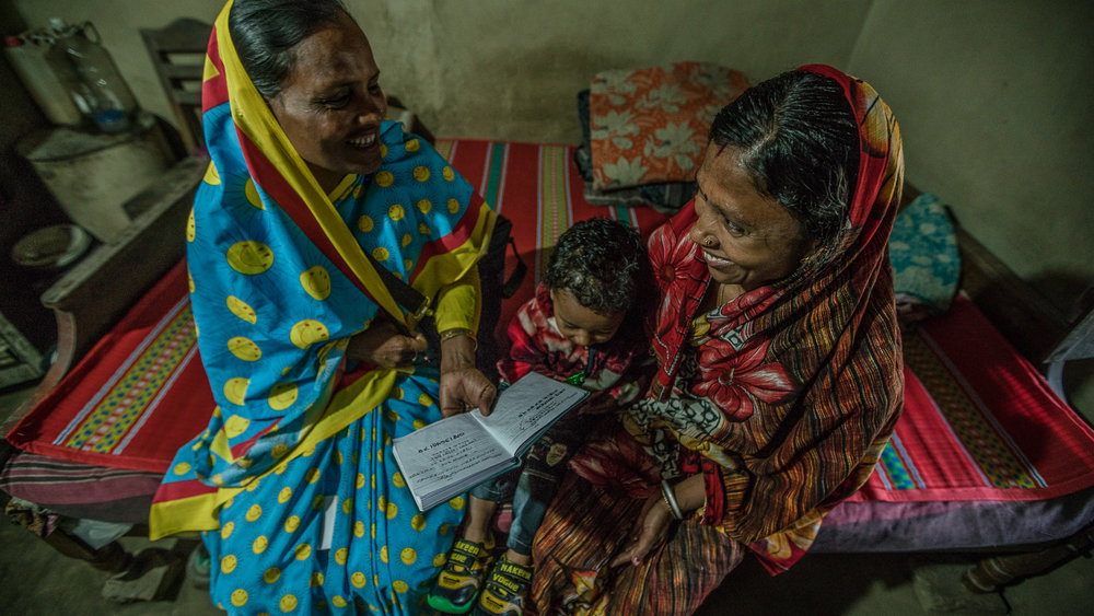 Halima Begum, a community service provider, educates Supriya Dae on child and maternal health.