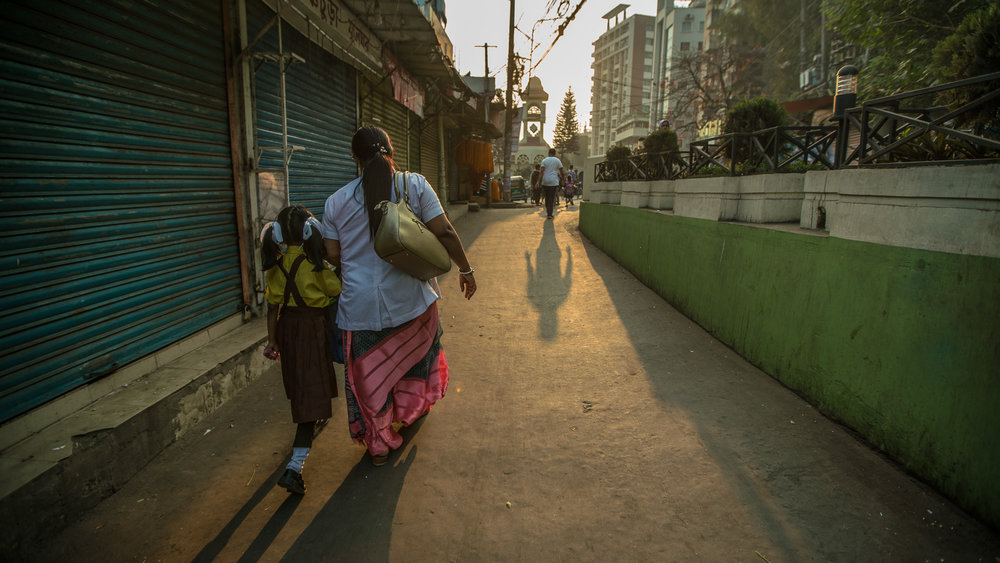 Shanta Das, a paramedic at Smiling Sun Clinic, walks her daughter to school in the morning before going to work.