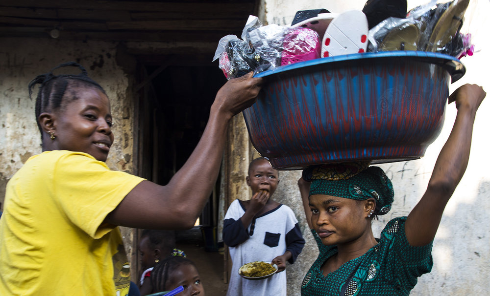 Mariatu Bangura, 18, of Rokupr, sells slippers to help provide for her son and herself.