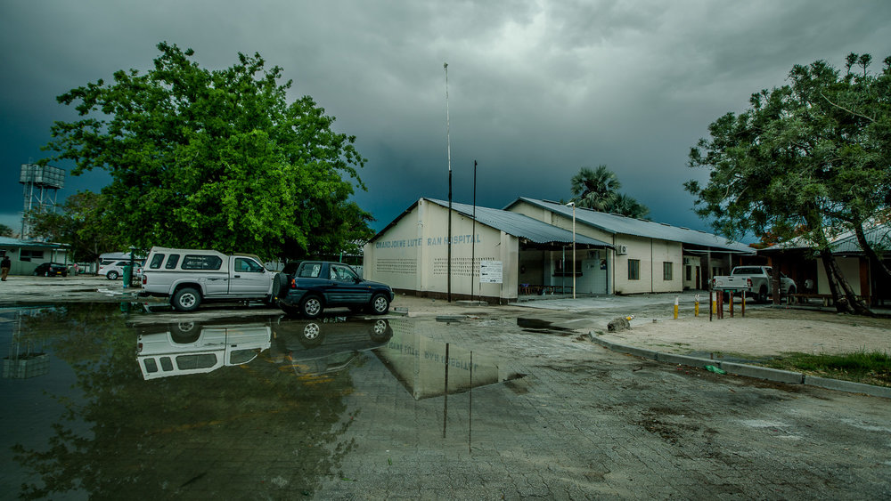 Onandjokwe Hospital serves as the primary health care center for the Onandjokwe District of the Oshikoto Region, which spans about 25,000 kilometers. Before decentralization, it was the only place where over 81,000 people could get HIV-related services. This photo was taken after one of the few  rains  during what should have been the region's rainy season. By the next morning, the ground was bone dry once more.