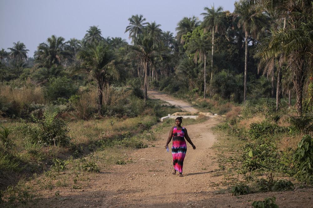 Aminata Kalokoh, of Makai Village, walks to her antenatal appointment at Konsho CHP.