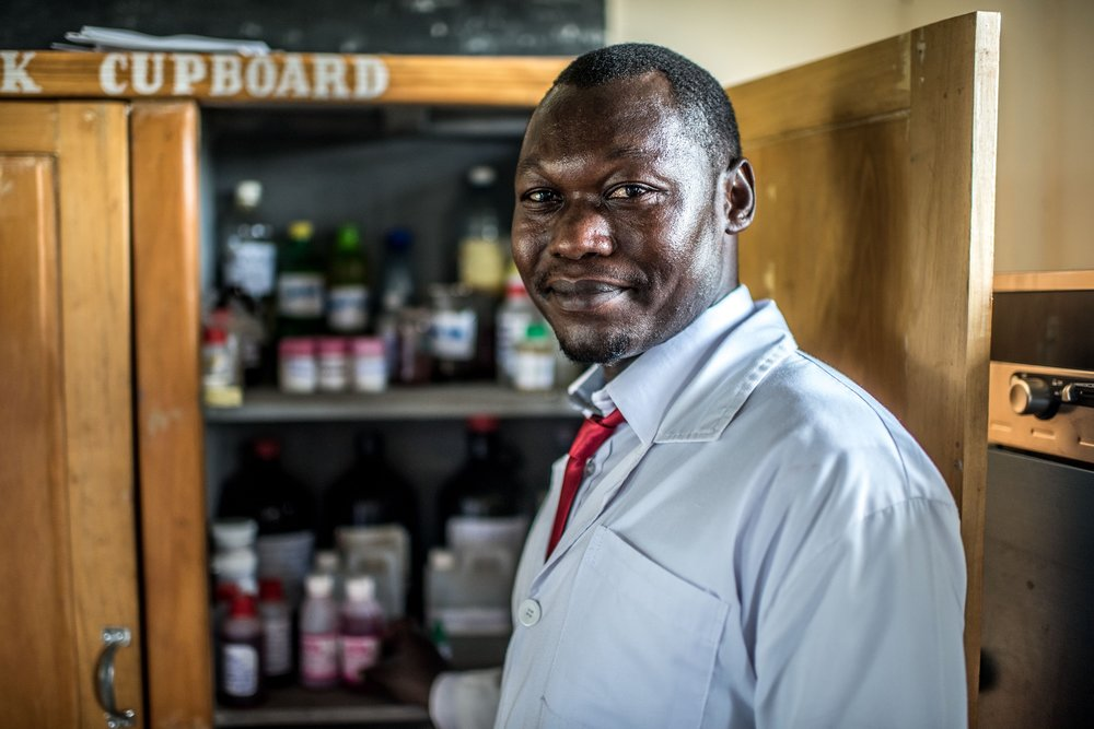 Cheptoyek Tom Albert, a 30 year old student at the Soroti Pharmacy School, photographed in the school's lab.