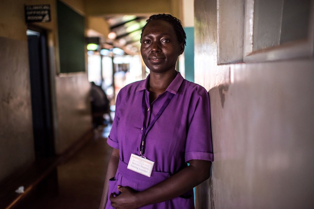 Nursing assistant Gubiika Teopista, photographed in the outpatient department of the Jinja Regional Referral Hospital in Jinja, Uganda.