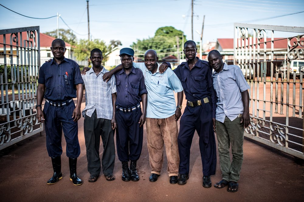 A team of security guards pose for a picture at the entrance to the Jinja Regional Referral Hopsital.