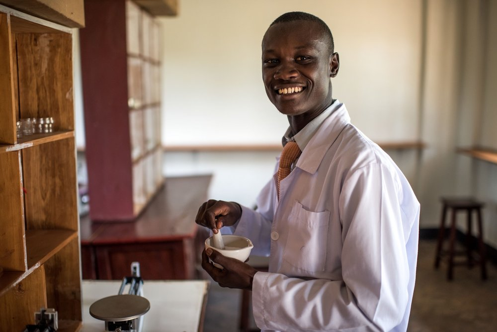 Dennis Odongo, 24, a student of the Soroti Pharmacy School, takes part in a practical excercise in the lab.