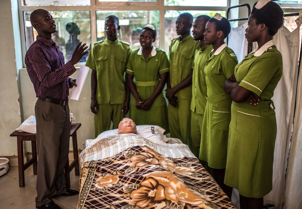 Edweo Sam, 32, a clinical instructor at the Good Samaritan School of Nursing & Midwifery in Lira, Uganda, teaches students how to take a patient's vital signs.