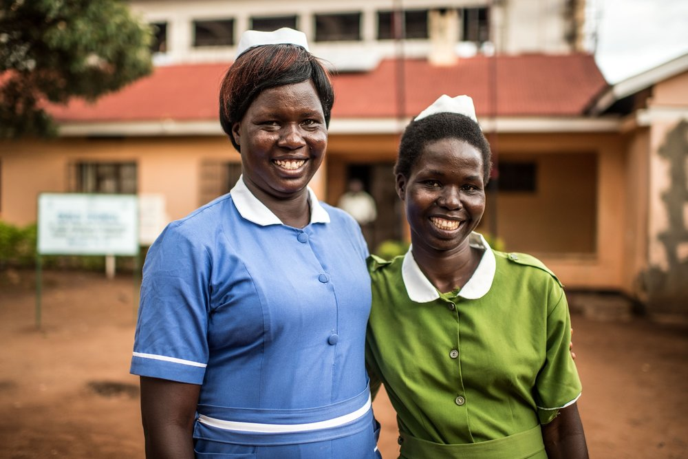 Beatrice Aciro, midwife and graduate of the Good Samaritan School of Nursing & Midwifery, photographed with her sister. Lira, Uganda.