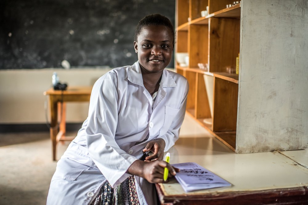Atim Olive, 24, a student at the Soroti Pharmacy School, photographed in the lab.