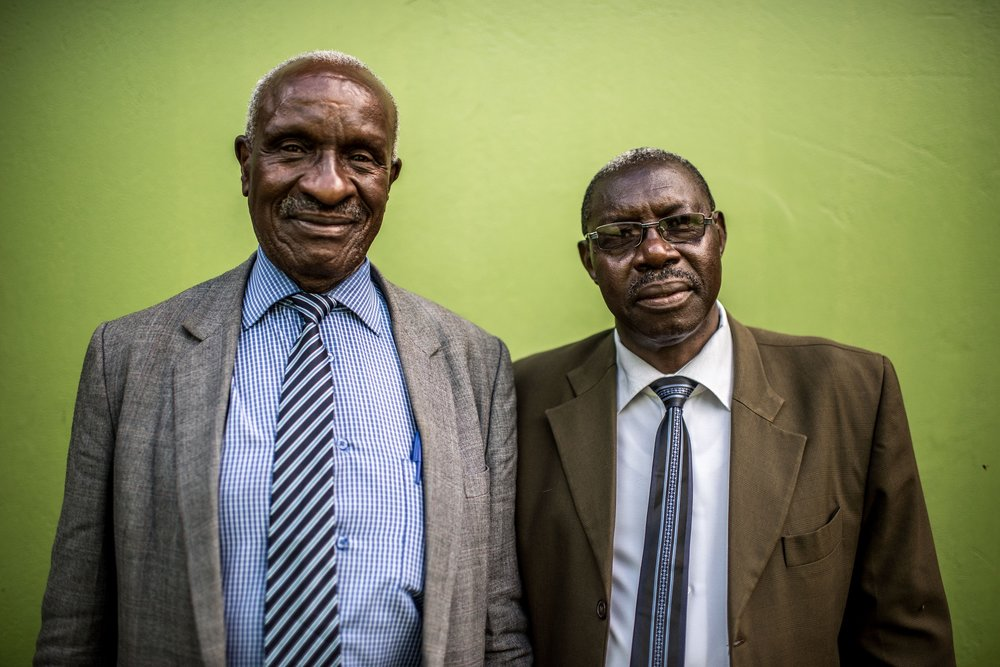 Augustine Egou (l), principal of Soroti Pharmacy School, photographed with a colleague in Soroti town, Uganda.