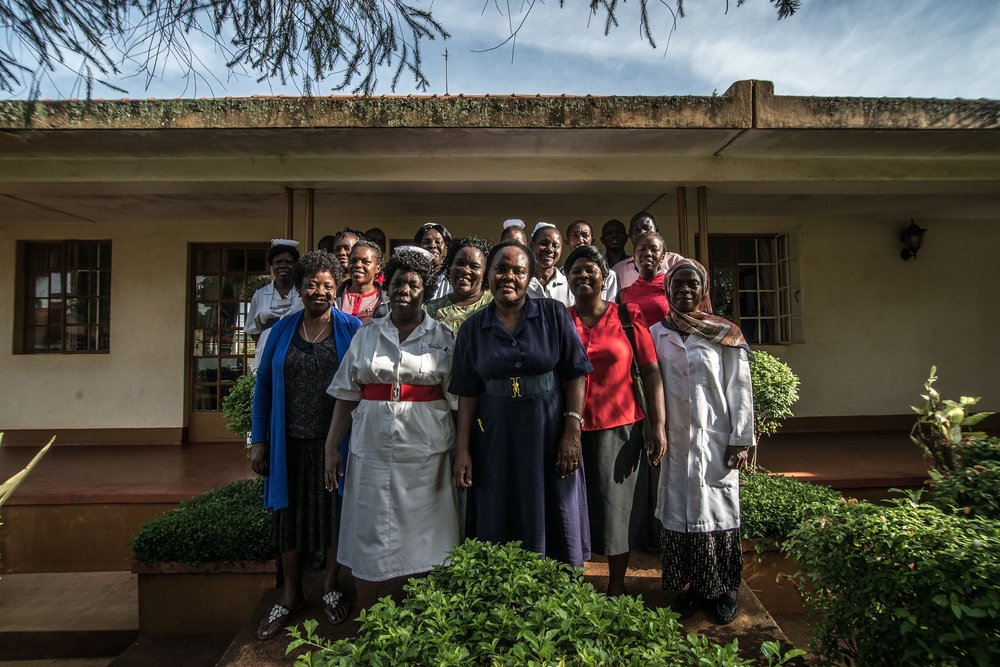Staff of the Jinja General Referral Hospital poses for a portrait. Jinja, Uganda.