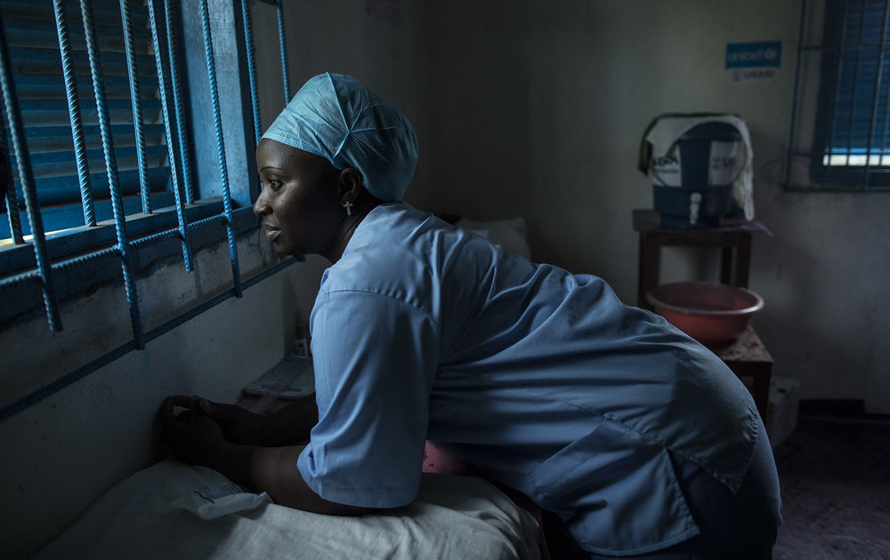 "BREWERVILLE, LIBERIA: Aug. 22, 2017 - Wislyne S. Yarh Sieh is a registered nurse and Officer in Charge (OIC) at Kpallah Community Clinic in Brewerville. Wisylne worked as a healthcare worker during the Ebola outbreak in 2014-2015. Healthcare workers like Wislyne were left isolated and alone to fight this mysterious disease from the heart of the jungle. But, she, along with many others, continued to fight. ""Being a nurse is like being a soldier. You cannot take your uniform off when there is battle. Then you are not a soldier. So I went on the frontline because I wanted to save lives,"" she remembers. 