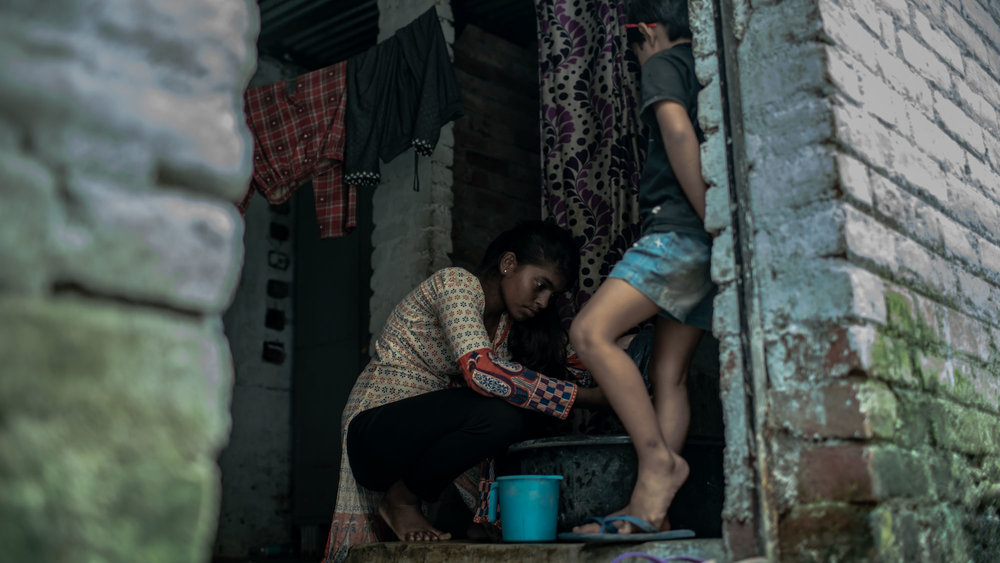Karin Sahu playing Laxmi doing washing in the scnene