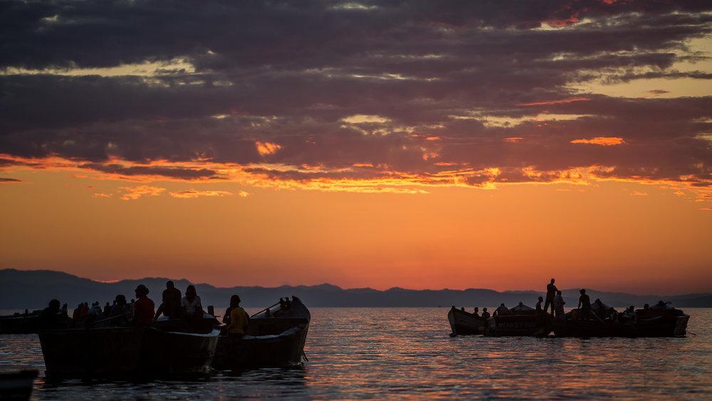 Fisherman in Masaka Bay prepare their boats for the nights fishi