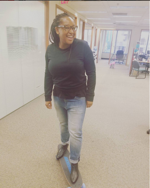 Movie director, Stella Meghie, trying out Olly's skateboard before giving it to Nick Robinson!