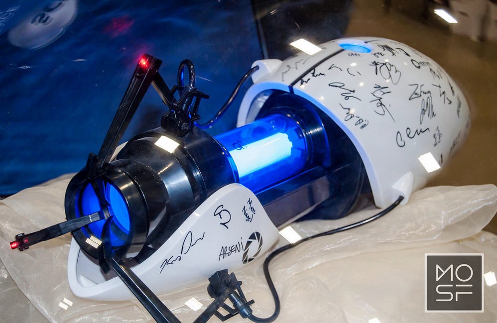 "A replica of the ""Aperture Science Handheld Portal Device"" was on display at the MoSF/Science Channel booth."