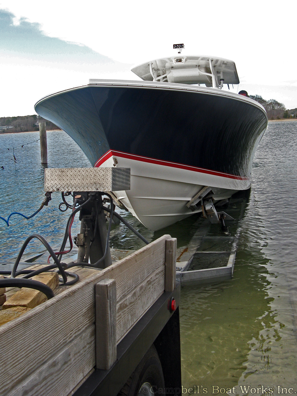 Boat Hauling Service Launching a Regulator in North Falmouth Mas