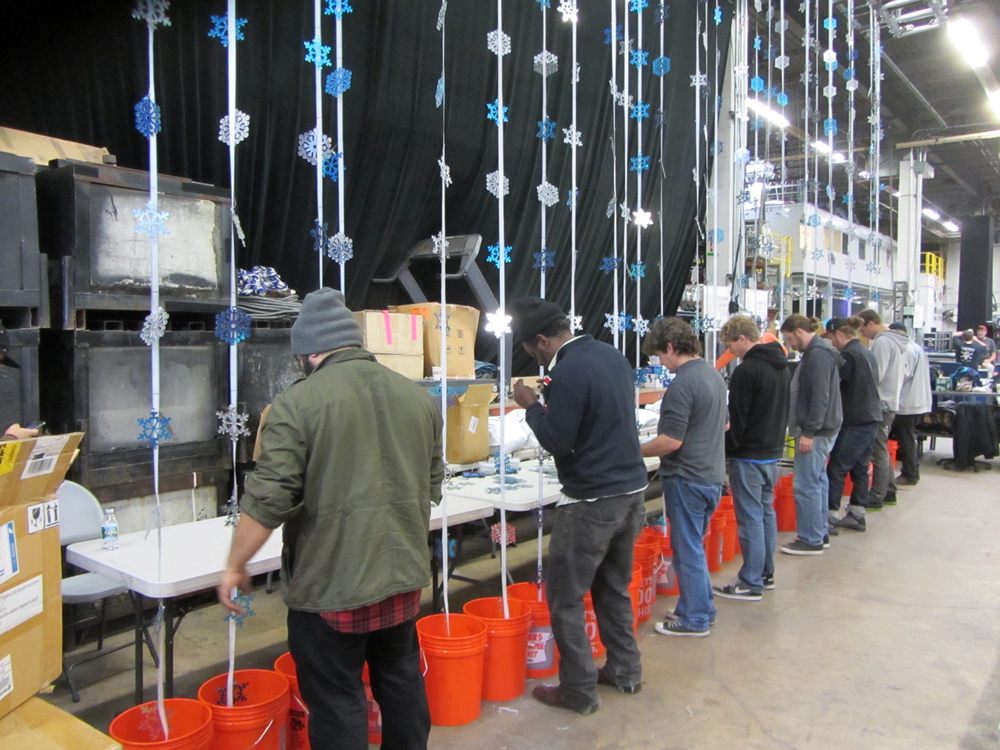 The team in workshop attaching thousands of mirrored snowflakes