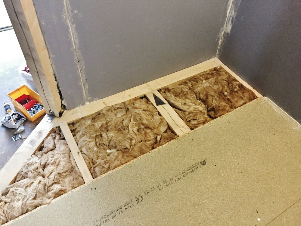 6 of 8:  Chipboard floor going into the booth, which is mounted on rubber.
